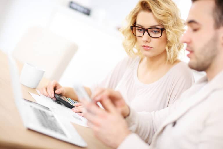 Young couple looking at documents and calculator